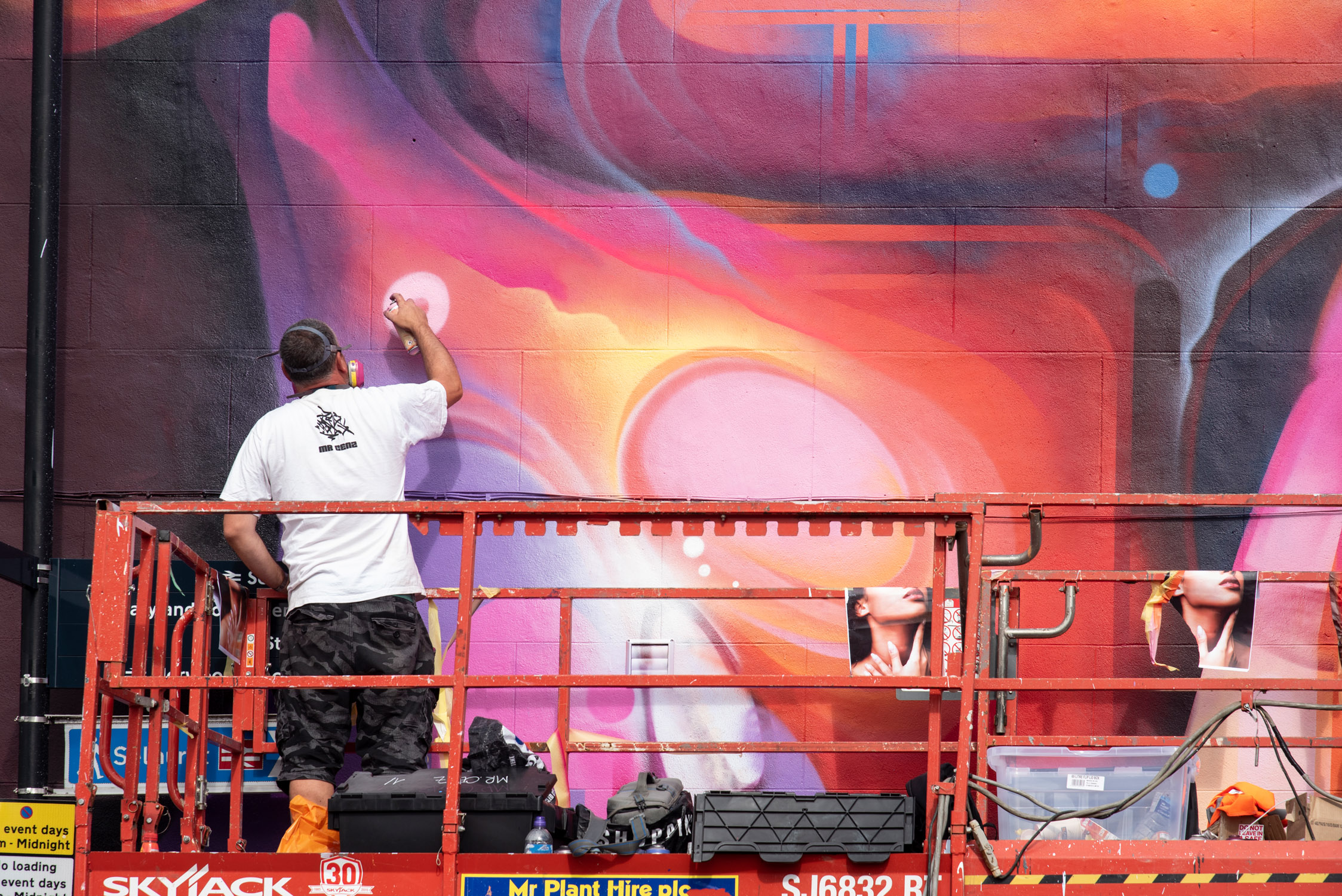 MR CENZ WORKING ON HIS HUGE MURAL