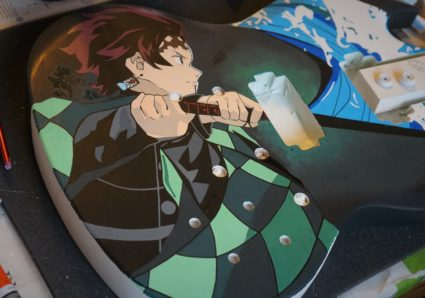 TANJIRO painting on a guitar with MOLOTOW ONE4ALL Acrylic Markers